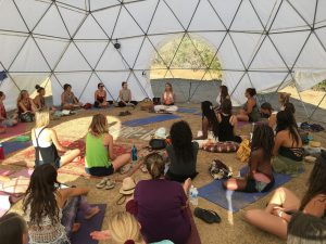 Beth Leone teaching a women's circle Taoist Arts at One Love Festival, Ojai, CA